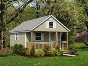 Cabin details: 12' x 20' • Siding: Custom Green • Trim: White • Shingles: Dual Gray • Options: End Vents • Porch Railing