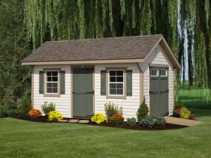 10x16' • Ivory Vinyl • Buckskin Trim • Avacodo Doors and Shutters • Weatherwood Shingles • Extra Single Deluxe Door(no transom) • Deluxe End Vent • Wood Ramp