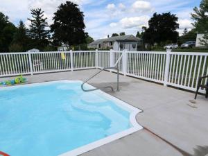 White picket fence around pool