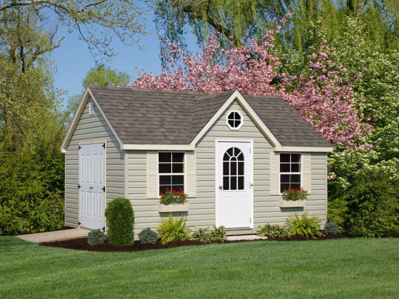 Shed Picture info: Size: 12 x 16 • Siding: Olive • Trim: Almond • Shingles: Weatherwood • Options: End Vents; 3' 11-Lite Door; 6' Steel Double Door; Flower Boxes; Octagon Window; Architectural Shingles
