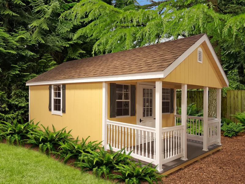 Cabin details – 12x24'/ Custom Colonial Yellow Duratemp / White Trim and Doors / Avocado Shutters / Earthtone Cedar Shingles – Options: Deluxe End Vent / Vinyl Porch Posts and Railing