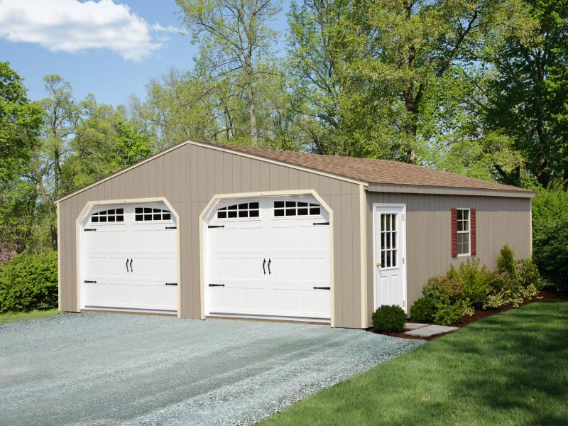 Shed Picture info: Size: 12' x 24' • Clay Siding • Navajo White Trim • Earthtone Cedar Shingles • Options: Red Shutters • Carriage House Garage Doors