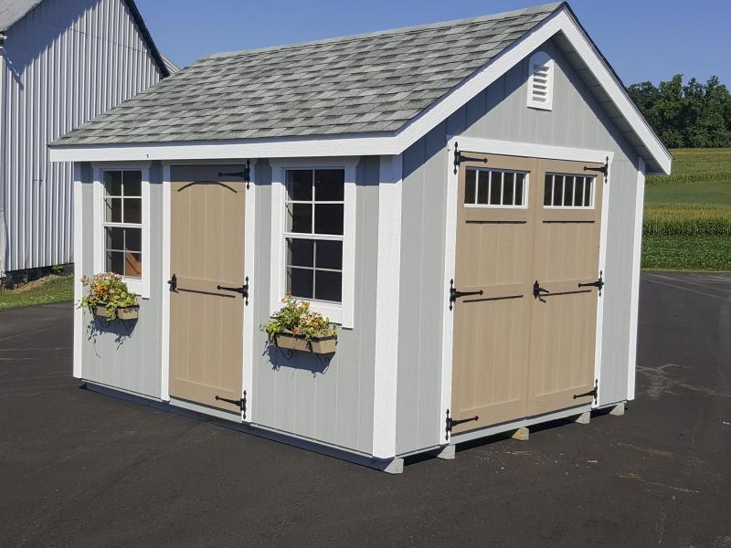 Shed Picture info: Size: 10 x 12 • Siding: Zook Gray • Trim: White • Doors: Buckskin • Shingles: Dual Gray • Options: Decorative Vent, Flower box holders with flower boxes, Doors with transoms