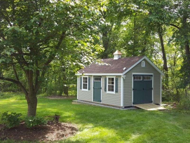 Shed Picture: Size 10x16 ~ Vinyl siding color: Wicker ~ doors: Avocado ~ trim white