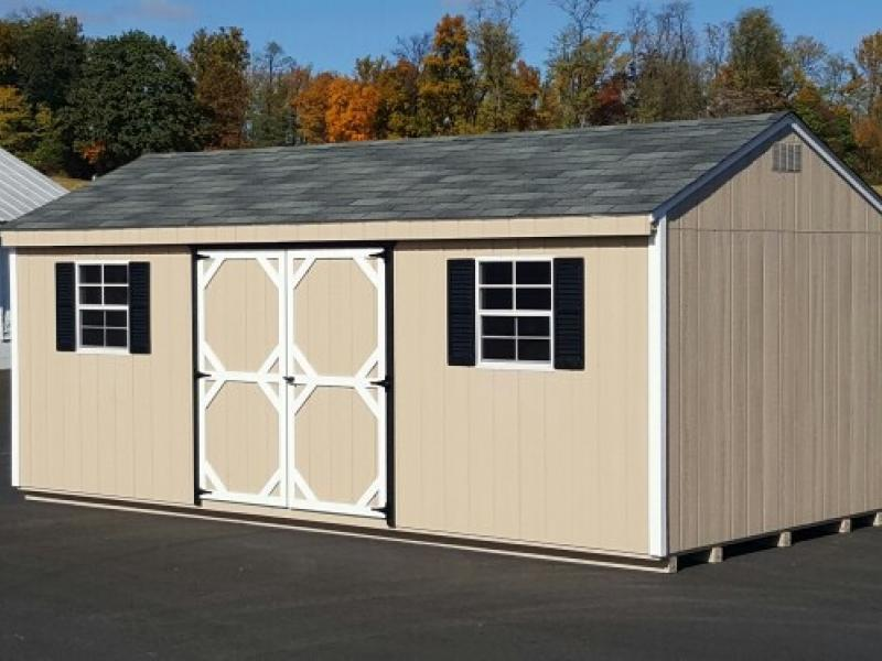 Shed Picture info: wood siding -12 x 24 pequea tan - white trim