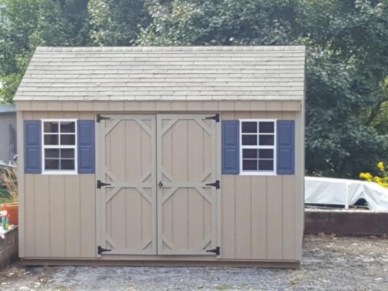 Shed picture info: wood siding - 10 x 12 Buckskin - blue shutters
