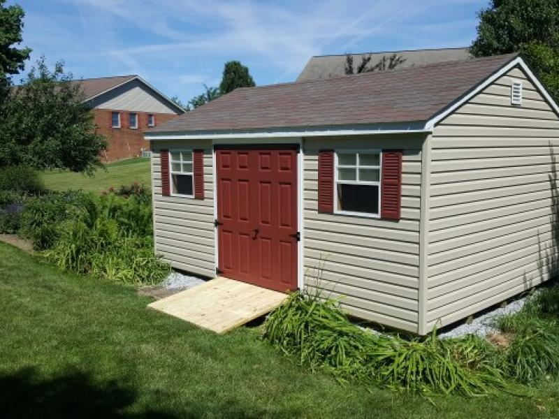 Shed Picture info: 10' x 14' Almond Vinyl siding -custom painted door
