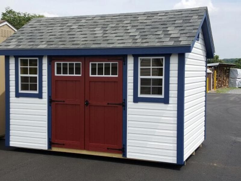 Shed Picture info: Size: 10 x 12 ~ Siding: White ~ Trim: Navy Blue ~ Doors: Stauffer Red
