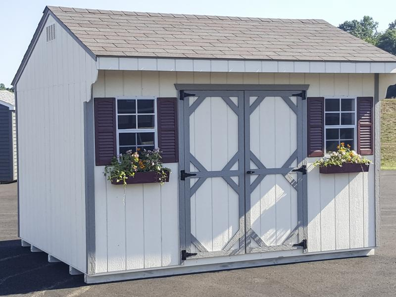 Shed Picture info: Size: 10' x 12' • Siding: Navajo White • Trim: Clay • Shingles: Aged Redwood • Options: End Vents, Red Shutters, Flower Boxes