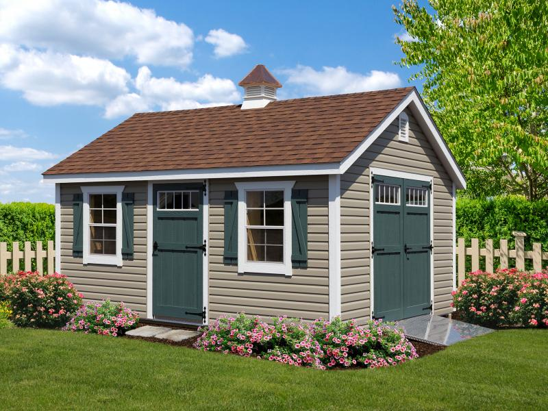 Shed picture info: 12x14 • Wicker Vinyl • Avacodo Doors • Z Shutters • Custom Brown Shingles • Extra deluxe single door w/transom • Cupola • Aluminum ramp • Deluxe end vent